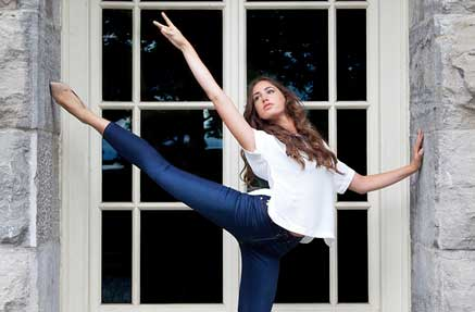 Woman wearing Second Yoga jeans and stretching in a ballet pose