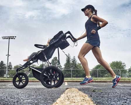 Woman running with a Mountain Buggy jogging stroller