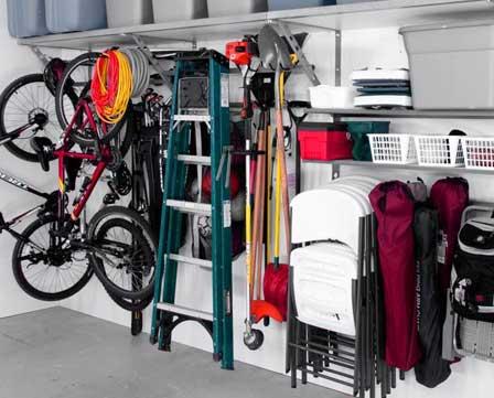 An organized wall in a garage using Monkey Bar Storage organization shelving and racks