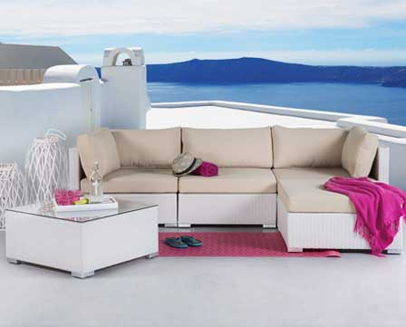 A Velago wooden patio lounge and dining set in white