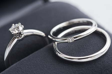 A set of wedding rings on a ring box, for the bride and groom