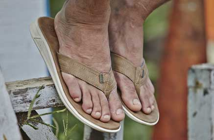 Close up of a man's feet in Reef flipflops
