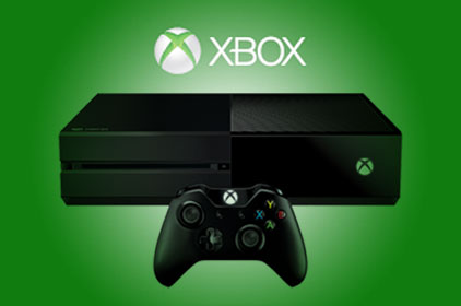 An Xbox One on a green background