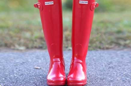 A pair of red Hunter rain boots
