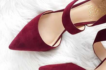 A pair of burgundy Vince Camuto heels